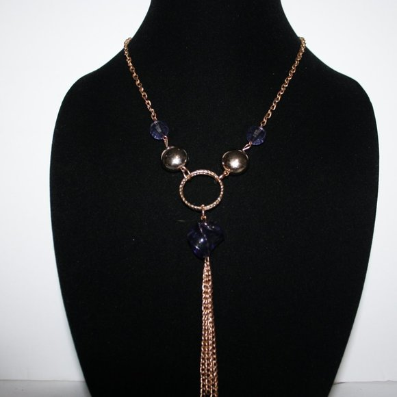 Beautiful long gold necklace with tanzanite beads